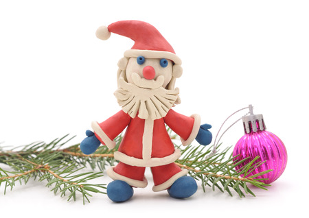 Plasticine Santa Claus isolated on a white background. Stock Photo
