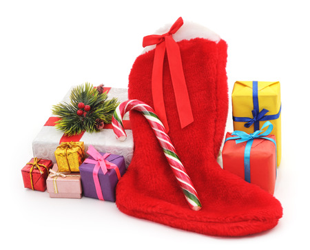 botas de navidad: Christmas boots with gifts on a white background.