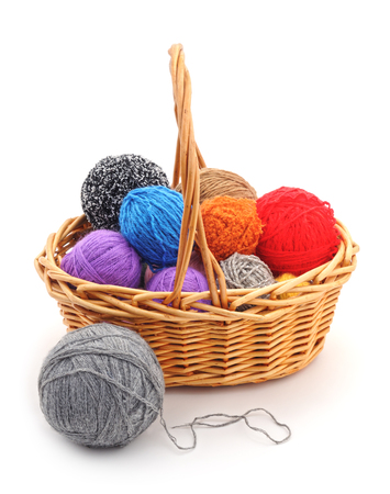 Basket with colored balls on a white background. Stock Photo