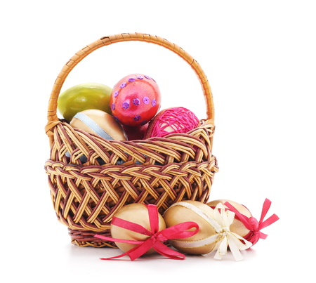 Easter basket with eggs isolated on a white background.