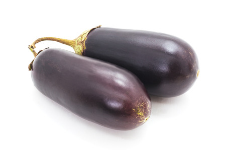 Two blue eggplant isolated on a white background. Standard-Bild - 115309147