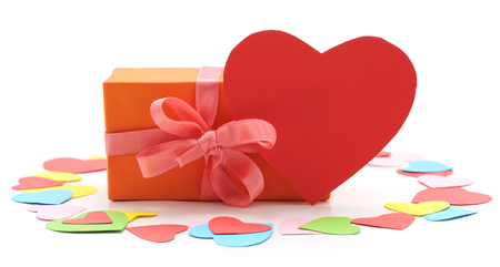 Gift and heart isolated on a white background. Standard-Bild - 115309173