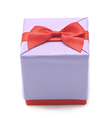 Gift box with red ribbon isolated on a white background. Standard-Bild - 115309180