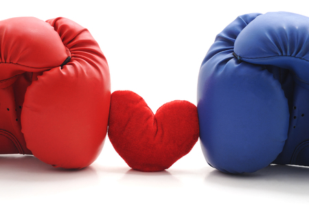 Boxing gloves and heart isolated on a white background. Standard-Bild - 116057209
