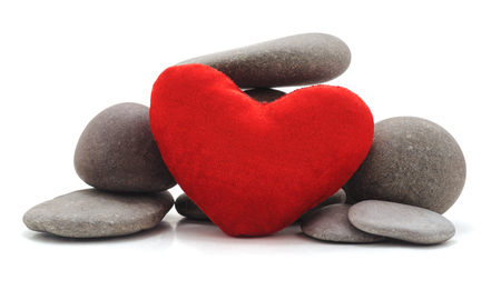 Stones and heart isolated on a white background. Standard-Bild - 116057250