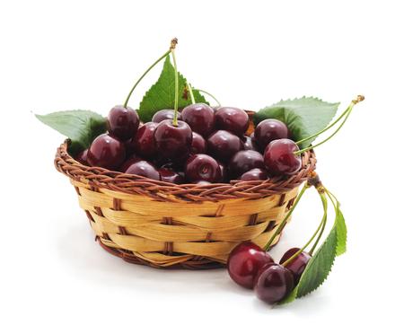 Cherries in the basket on a white background. Standard-Bild - 116057284