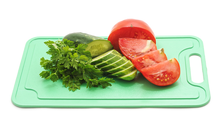 Fresh farmers garden vegetables cooking on the board on a white background. Standard-Bild - 116057335