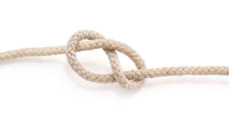 Marine knot from the old rope isolated on a white background.