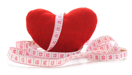 Heart and centimeter tape isolated on a white background. Banque d'images - 119185890