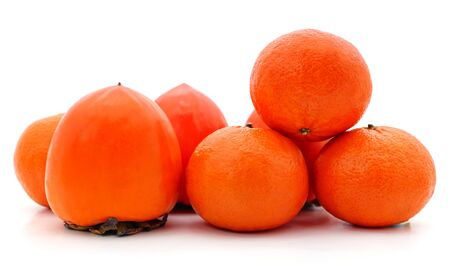 Orange persimmons and mandarin isolated on a white background.