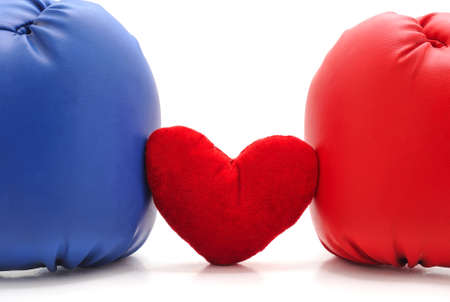 Boxing gloves and heart isolated on a white background.