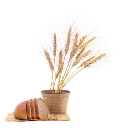 Bread and ears of wheat on a sack isolated on a white background. Stock Photo