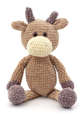 One knitted brown bull isolated on a white background.