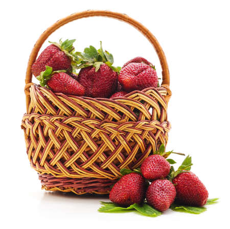 Red strawberries in basket and rose isolated on white background. 免版税图像