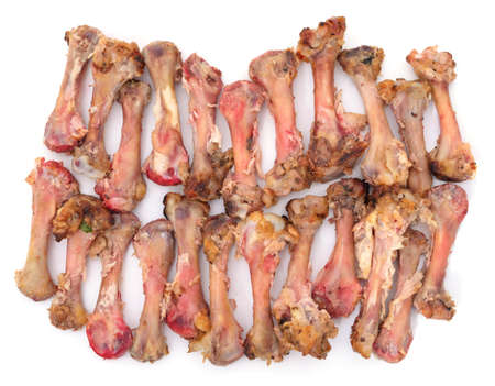 Pile of chicken bones isolated on a white background.