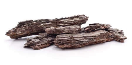 Pieces of brown bark isolated on a white background.