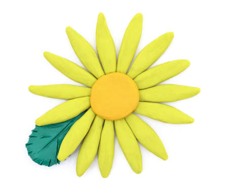 Plasticine yellow flower with leaves isolated on a white background.