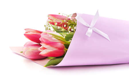Bouquet of tulips in a pink wrapper isolated on white background.