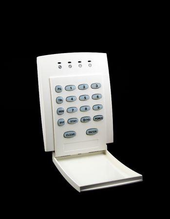 Alarm LED keypad isolated on black background photo