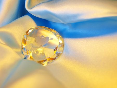 Crystal stone with an inscription \FOREVER\ on a blue background photo