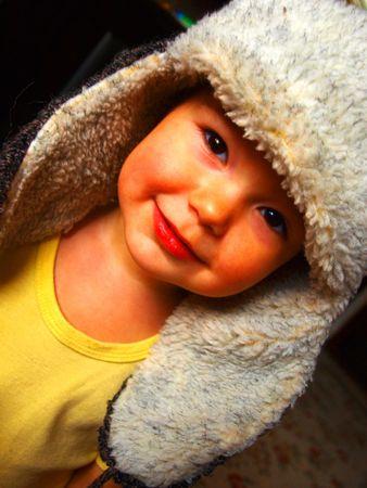 xavi: The child in a cap close up Stock Photo