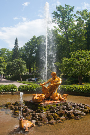 breaking off: Peterhof. The triton who is breaking off a mouth to a dragon. Sculpture of the Hothouse fountain.