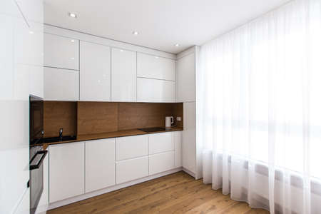 Interior photography, large white kitchen studio in a modern style, minimalism