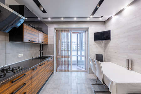 interior photo of a modern large kitchen in dark colors of wood