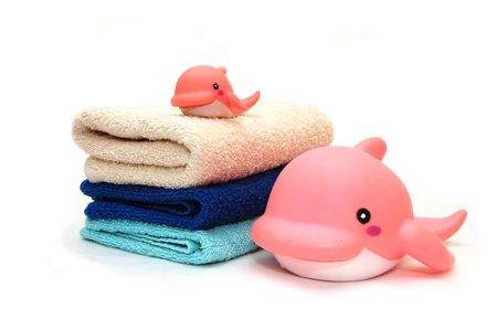 The combined colour towels with a toy dolphin photo