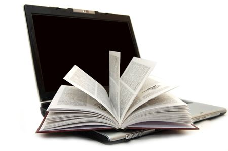super highway: The open book laying on the laptop