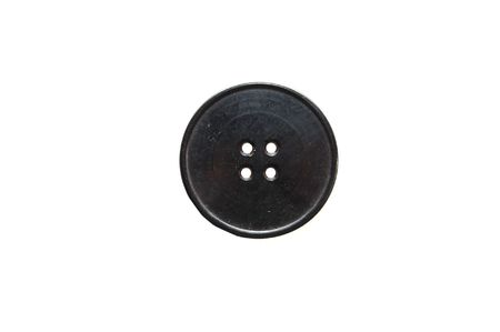 Close up of a black button on a white background photo