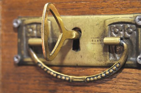 Old key in a keyhole photo