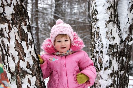 Winter portrait of the little girl in the pink photo