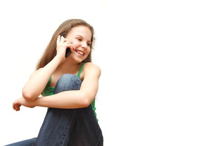 The young girl the teenager speaks on the phone Stock Photo - 4851976