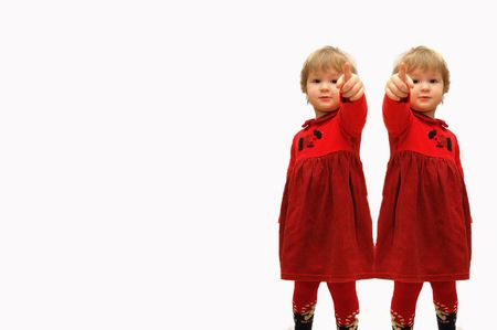Two girls with the extended finger forward on a white background Stock Photo - 4851930