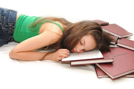 girl sleeping with her head on an open book  Stock Photo