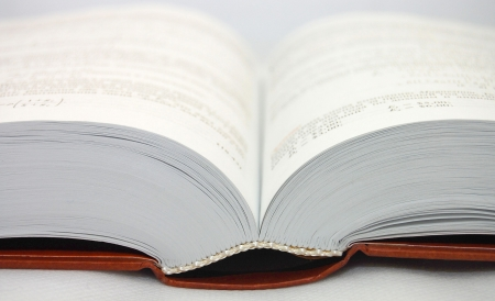 unreadable: The open textbook under the finance Stock Photo