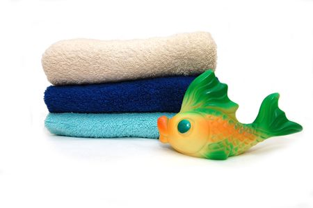 The combined colour towels with a toy Fish Stock Photo - 4866095