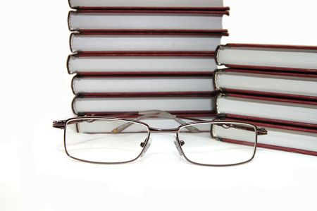 Eyeglasses laying about books on a white background Stock Photo - 4866085