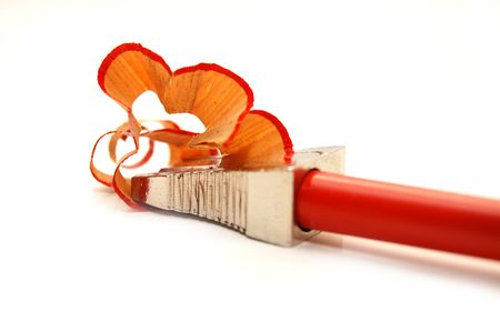 red pencil and sharpener with a shaving Stock Photo - 4882497