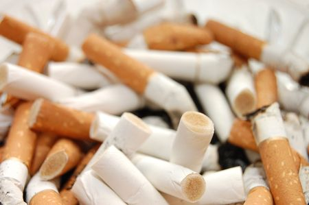 Ashtray full of cigarette butts photo