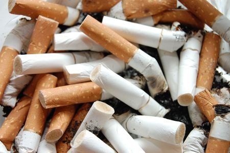 ashtray: Ashtray full of cigarette butts Stock Photo