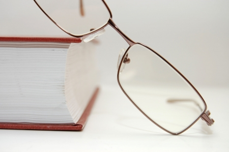 spectacles laying on the closed book Stock Photo - 4906582