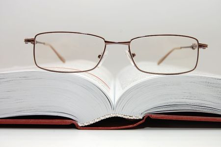 spectacles laying on the open book Stock Photo - 4906629