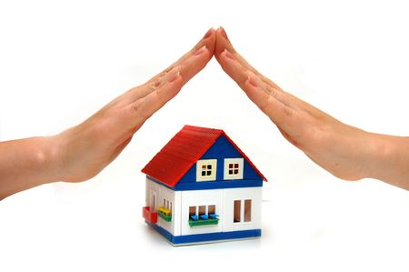hands over a small house Stock Photo - 4932808