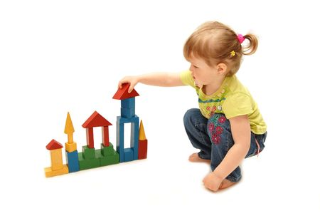 little girl playing with cubes Stock Photo - 4932046