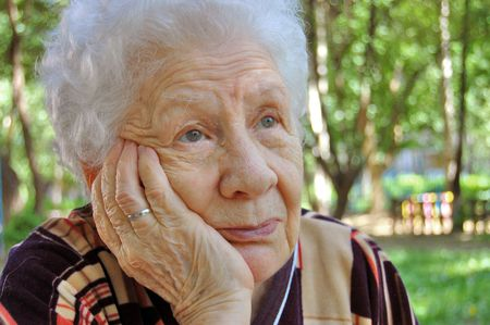 Portrait of the old woman on a green background Stock Photo - 4976815