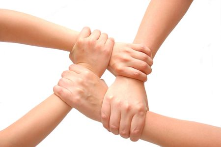 linked together: Image of crossed hands isolated white