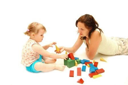 Mother with a daughter is played by cubes   photo