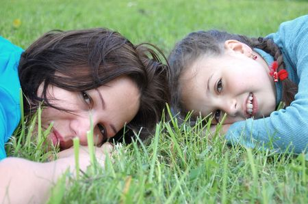 Mother resting outdoor with daughter photo